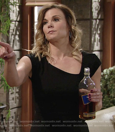 Phyllis's black dress with asymmetrical neckline on The Young and the Restless
