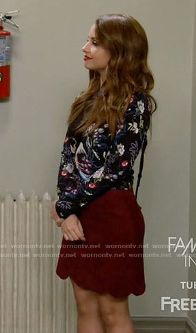Sofia's bird print top and red scalloped skirt on Young and Hungry