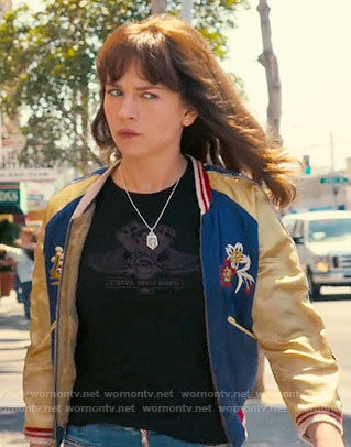 Sophia's blue and yellow embroidered bomber jacket with Japan map on the back on Girlboss