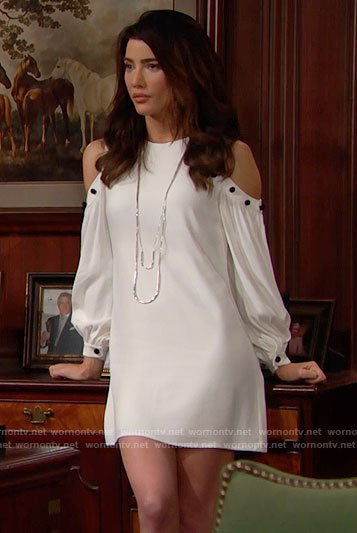 Steffy's white cold shoulder dress with black buttons on The Bold and the Beautiful