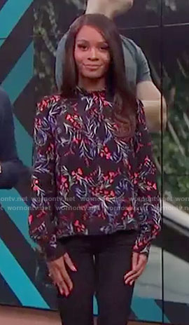 Zuri Hall's black floral blouse on E! News