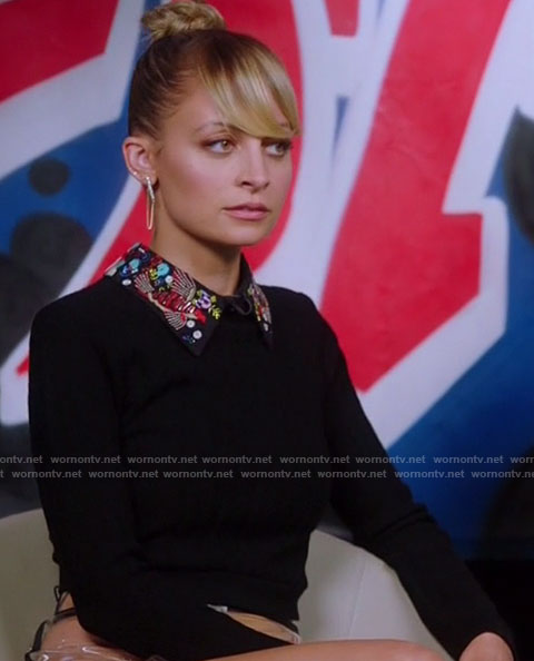 Portia's black embroidered collar top on Great News