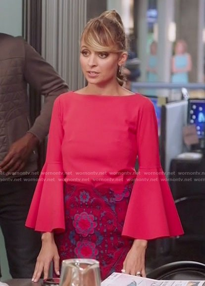 Portia's red bell sleeve top and lace skirt on Great News