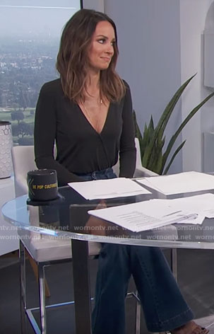 Catt's black wrap top and flare jeans on E! News Daily Pop