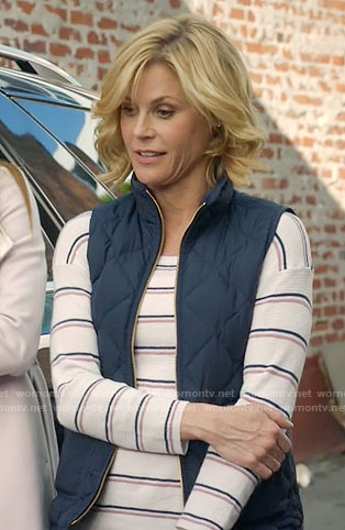 Claire's striped sweater and navy quilted vest on Modern Family