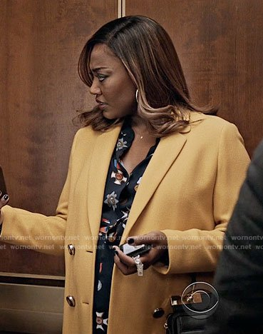Daisy's medal print dress and yellow coat on Madam Secretary
