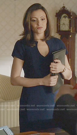 Emily's navy split-neck dress on Designated Survivor