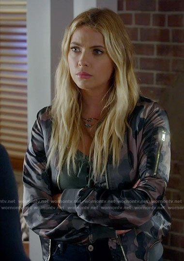 Hanna's lace-up top and camo bomber jacket on Pretty Little Liars