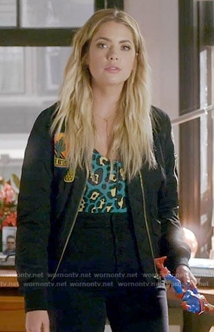 Hanna's green leopard print top and patched bomber jacket on Pretty Little Liars