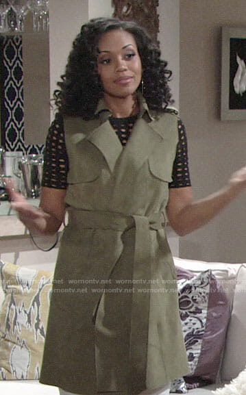 Hilary's black eyelet top and green sleeveless trench coat on The Young and the Restless