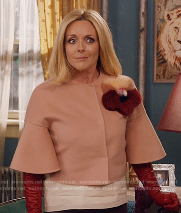 Jacqueline's pink jacket with fur flower on Unbreakable Kimmy Schmidt