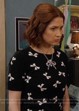 Kimmy's black bow print top on Unbreakable Kimmy Schmidt