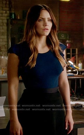 Paige's navy flutter sleeve top and black skirt on Scorpion