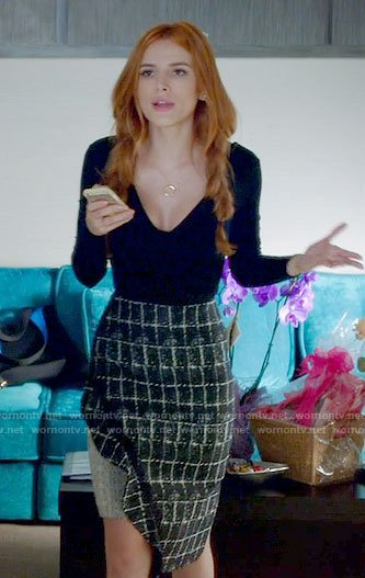 Paige's black v-neck top and checked skirt on Famous in Love