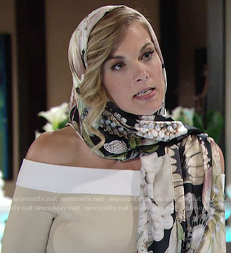Phyllis's beige off-shoulder dress with white trim and floral scarf on The Young and the Restless