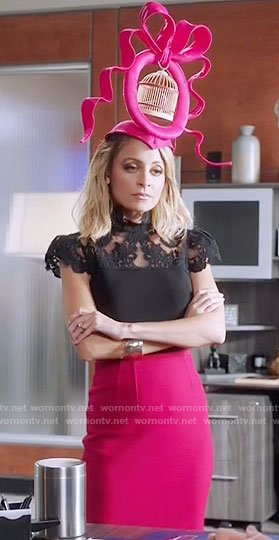Portia's black lace top and pink skirt on Great News