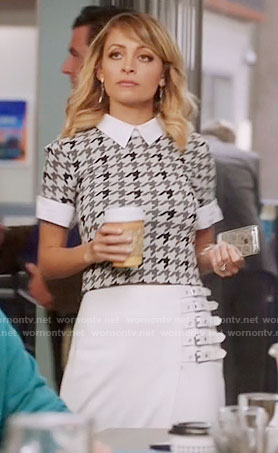 Portia's grey houndstooth top and white buckled skirt on Great News