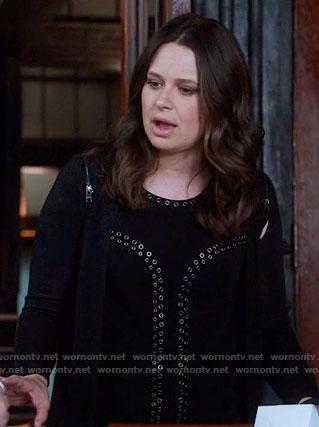 Quinn's black eyelet top and zip-shoulder cardigan on Scandal