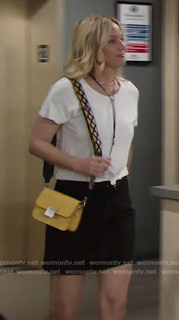 Sharon's yellow bag with embroidered strap on The Young and the Restless