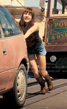 Sophia's tan boots on Girlboss
