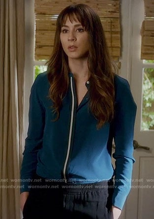 Spencer's teal shirt with white stripe on Pretty Little Liars