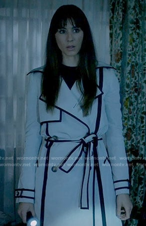 Spencer's white trench coat with black trim on Pretty Little Liars