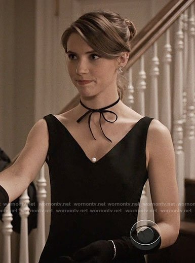Stevie's black v-neck dress with pearl on Madam Secretary