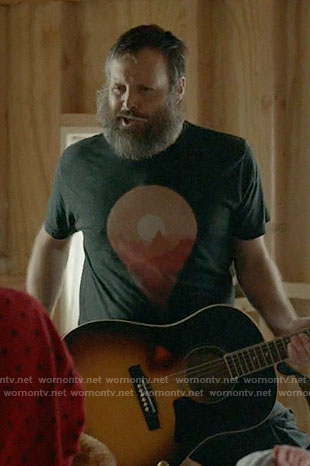 Tandy's black sun graphic t-shirt on Last Man on Earth