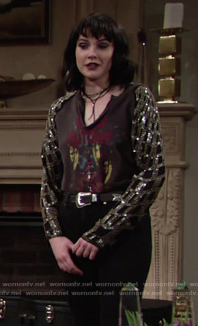 Tessa's black graphic tee with sequin sleeves on The Young and the Restless