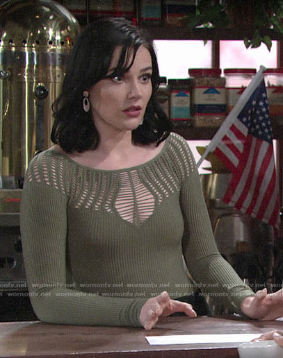 Tessa's green laddered top on The Young and the Restless