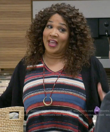 Yolanda's striped v-neck top on Young and Hungry