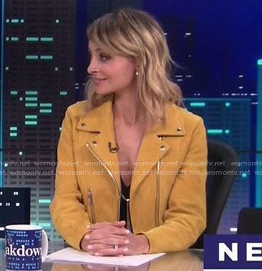 Portia's yellow moto jacket on Great News