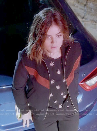 Aria's black bird print top and chevron jacket on Pretty Little Liars