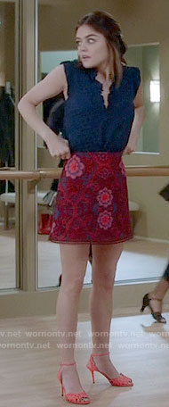 Aria's red lace skirt and blue dotted top on Pretty Little Liars
