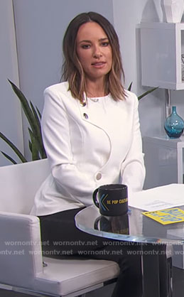 Catt's white jacket on E! News Daily Pop