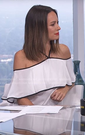 Catt's white halter top with black trim on E! News Daily Pop