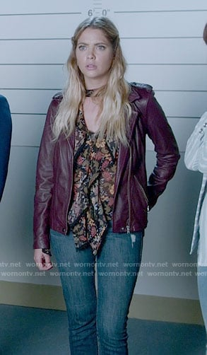 Hanna's floral ruffled front blouse and purple leather jacket on Pretty Little Liars