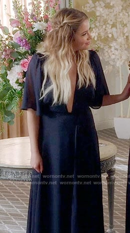Aria's black top with floral sleeves on Pretty Little Liars