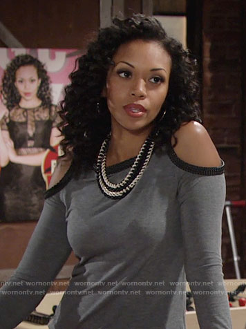 Hilary's grey cold shoulder top with black trim on The Young and the Restless
