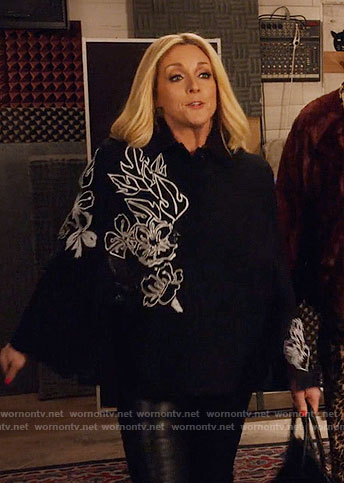 Jacqueline's black cape with white floral embroidery on Unbreakable Kimmy Schmidt
