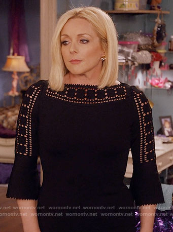 Jacqueline's black laser cutout dress on Unbreakable Kimmy Schmidt