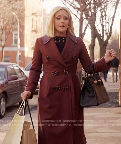 Jacqueline's burgundy coat on Unbreakable Kimmy Schmidt