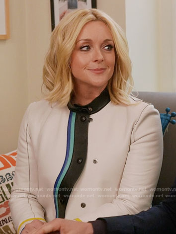 Jacqueline's white jacket with wavy trim on Unbreakable Kimmy Schmidt
