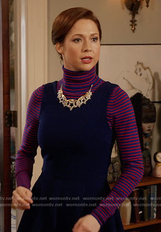 Kimmy's red striped turtleneck and navy dress on Unbreakable Kimmy Schmidt