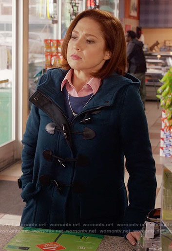 Kimmy's teal toggle coat on Unbreakable Kimmy Schmidt