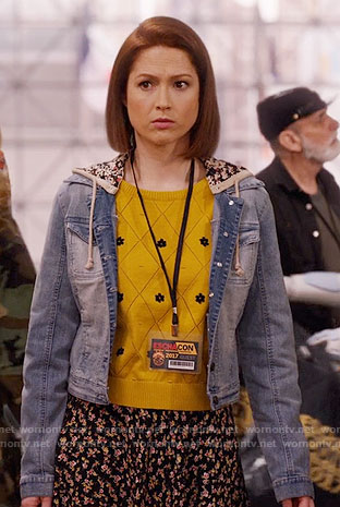Kimmy's yellow daisy sweater and hooded denim jacket on Unbreakable Kimmy Schmidt