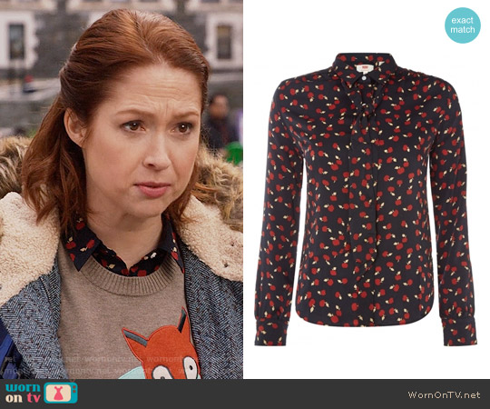 Levi's Apple Print Blouse worn by Kimmy Schmidt on Unbreakable Kimmy Schmidt