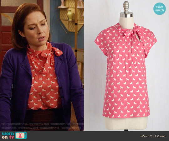 ModCloth Up, Up and Amaze Top in Unicorns worn by Ellie Kemper on Unbreakable Kimmy Schmidt