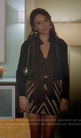 Mona's brown tie neck blouse and striped skirt on Pretty Little Liars