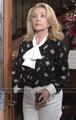 Nikki's black floral blouse with white tie neck on The Young and the Restless